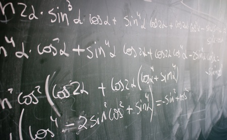 Blackboard with trigonometric formulas and numbers written on it photo
