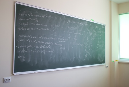 Blackboard with mathematical formulas in a modern classroom photo