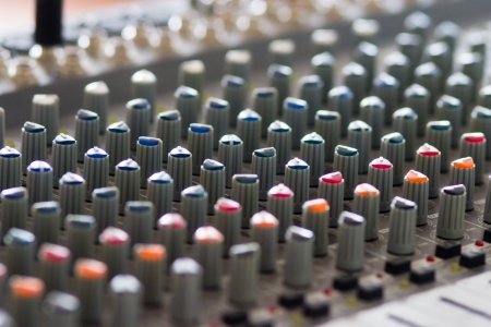 Close-up of dj studio audio editing panel photo