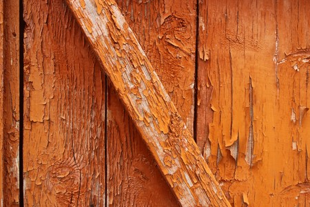Peeled paint falling off old wooden door photo