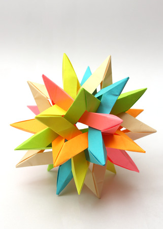 Colorful modular origami paper star isolated on white Standard-Bild