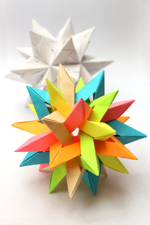 Colorful modular origami paper star with white star in the background