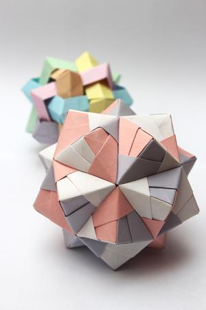 Colorful modular origami balls isolated on white background photo
