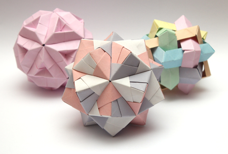 Group of colorful modular origami balls isolated on white background