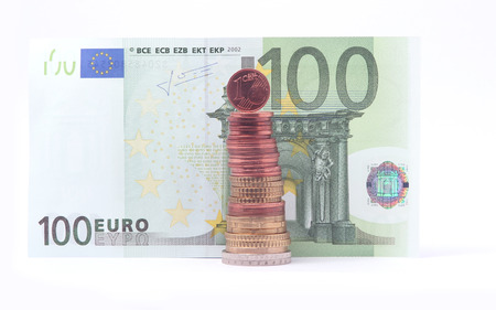 1 Cent Coin Standing On Top Of Stack Of Euro Coins Near 100 Euro