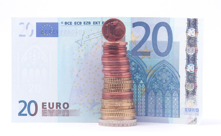 1 Cent Coin Standing On Top Of Stack Of Euro Coins Near 20 Euro