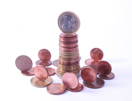 1 Cent Coin Falling From Stack Of Euro Coins Symbol For Economy