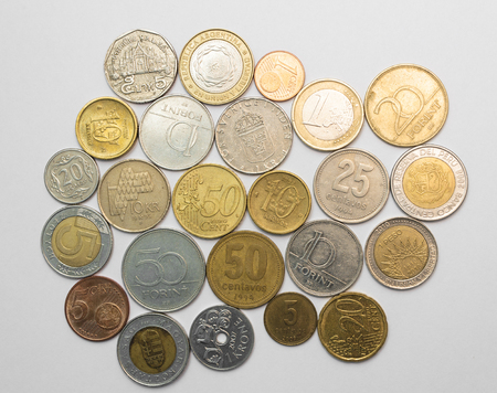 different countries: Collection of coins from different countries isolated on white Stock Photo