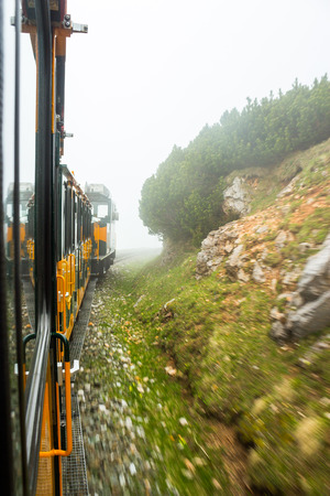 schneeberg: Foggy view out of the window of the Schneeberg train going up the mountain in lower Austria
