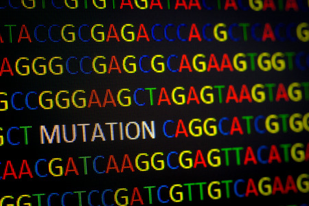 sequence: DNA sequence with colored letters on black background containing mutation Stock Photo