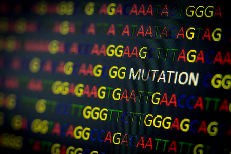 DNA sequence with colored letters on black background containing mutation Standard-Bild