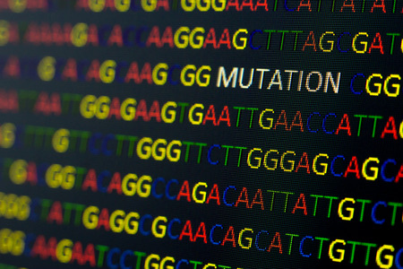 mutation: DNA sequence with colored letters on black background containing mutation Stock Photo