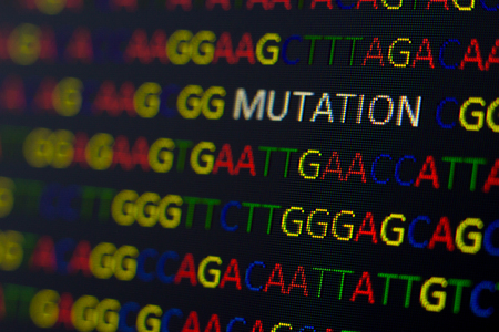 nucleotides: DNA sequence with colored letters on black background containing mutation Stock Photo