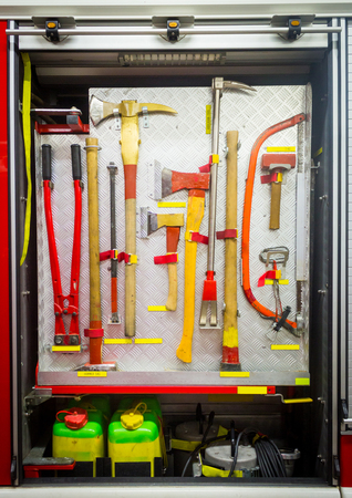 Yellow sharp firefighting tools in fire truck