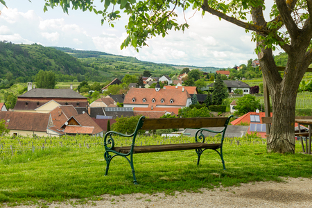 austrian village: Bench in austrian village with view over vineyards