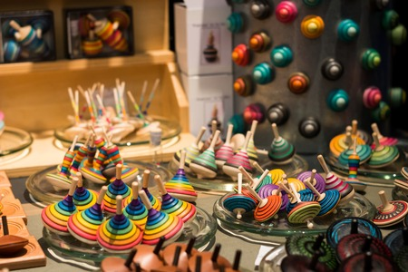 Market stall full of wooden spinning tops Standard-Bild