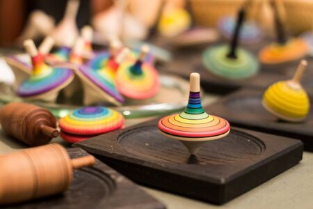 Colorful wooden spinning top Standard-Bild