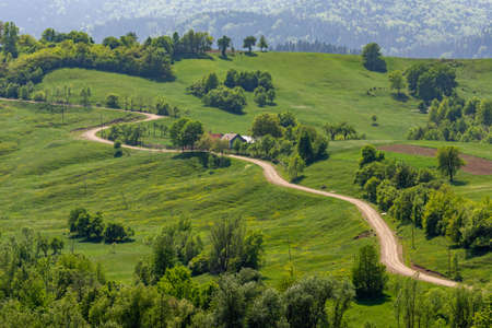 Beautiful sinuous road in Bucovina rural area, Romania Banque d'images