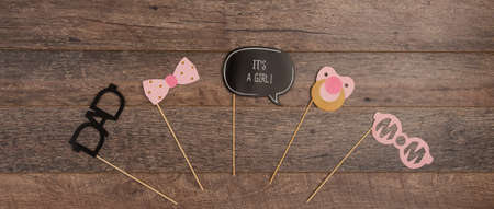 Baby christening photo booth props on wooden background