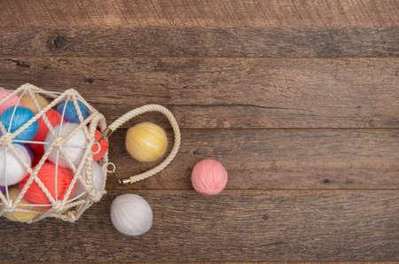 White knit basket on a wooden background Reklamní fotografie