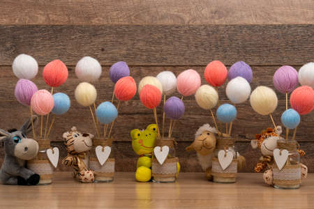 Personalized centerpiece jars with stuff toys for baptism