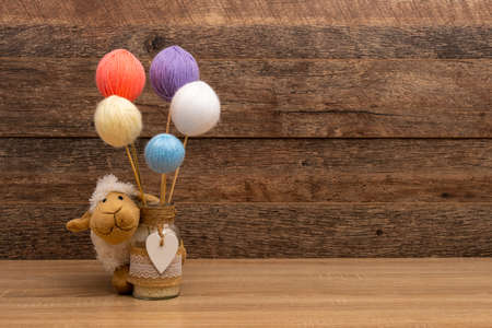 Stuffed sheep and pastel color wool balls
