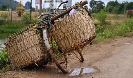 village man: All around Asia you will find bicycles overloaded with too much cargo and just simple baskets
