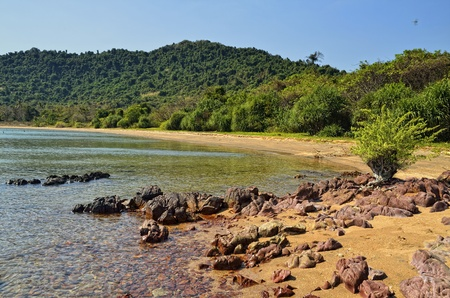 Yellow sand, green trees and beautiful sea will welcome you in this Cambodian Island Stock Photo - 13402358