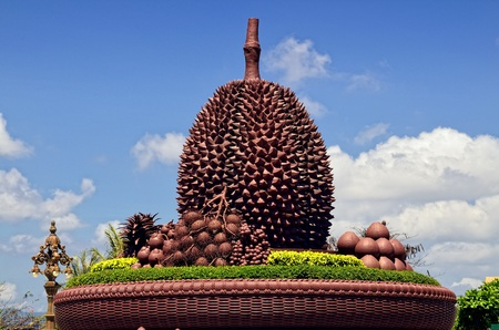 Funny and unique roundabout in the Cambodian city of Kampot  On the roundabout appears several typical tropical fruits with a huge durian in the center  photo