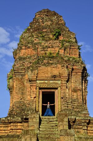 Girl enjoying views and freedom from the top of Phnom Bakheng temple, Angkor, Cambodia Stock Photo - 13553820