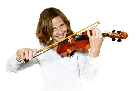 Girl playing the violin - Isolated in white background photo