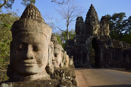 front gate: Heads in line on the bridge in front of the South Gate to Angkor Tom, Cambodia