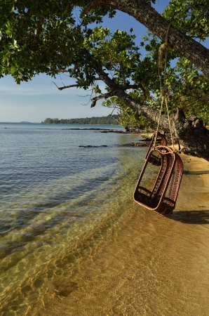 Nothing better than relax at this swing while the sun goes down in this paradise beach at a Cambodian island  photo