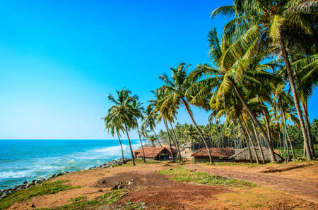 Fishermen hut in the tropical village near the blue ocean in Varkala, Kerala, India photo
