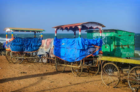 Old carts on beach in Pondicherry, Tamil Nadu, India photo