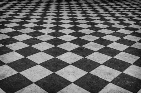 Black and white checkered marble floor pattern Archivio Fotografico