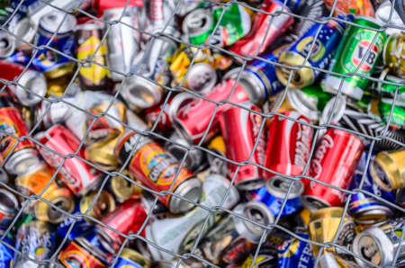 crushed aluminum cans: Different drinks cans for recycling saved  into a container for recycling in  Queen Elizabeth Park.  Masterton, New Zealand. Soft selective focus and  shallow depth of field