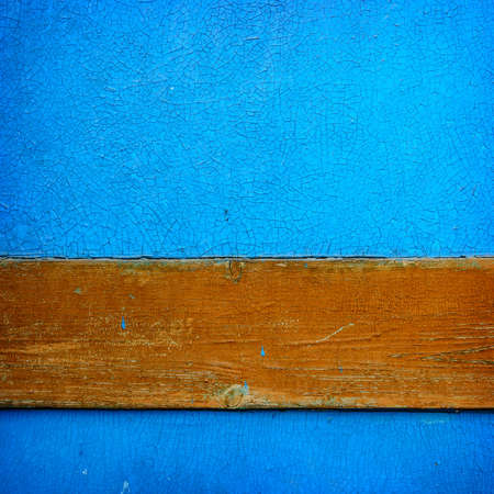 Blue and orange grunge wood close-up background. Painted old wooden wall. photo