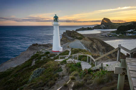 Castlepoint Lighthouse lookout over the small bay that fishing boats go out. New Zealand Stock Photo