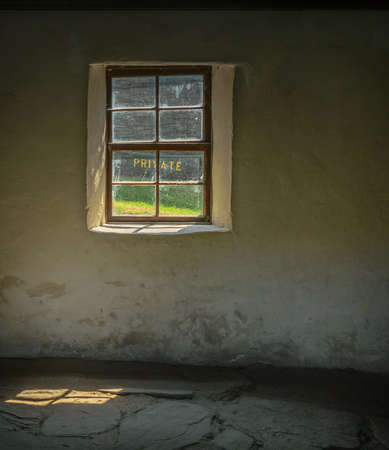 Window in abandoned old house in Arrowtown Chinese settlement, New Zealand