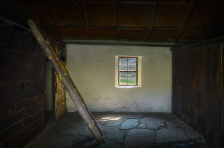 Interior of abandoned old house in Arrowtown Chinese settlement, New Zealand photo