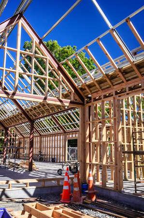 New residential construction home framing against a blue sky Reklamní fotografie