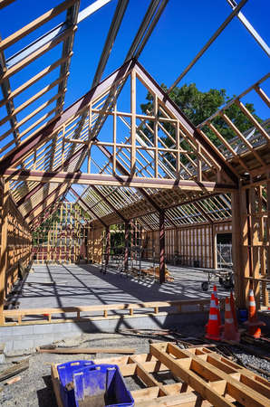 residential home: New residential construction home framing against a blue sky