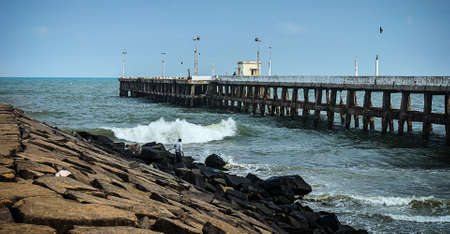 oceanside: Old pier on a summer day at the oceanside in Pondicherry. Tamil Nadu, India