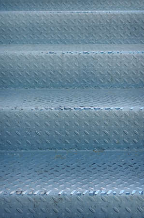 diamond plate background: Stairs grunge of old metal diamond plate background. Soft selective focus and shallow depth of field Stock Photo