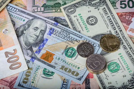 global currencies: A collection of various foreign currencies from countries spanning the globe. Many different currencies as colorful background concept global money