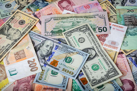 foreign currency: A collection of various foreign currencies from countries spanning the globe. Many different currencies as colorful background concept global money