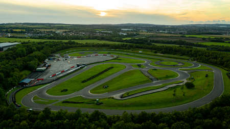 Aerial drone view of a go kart car race track circuit at sunset