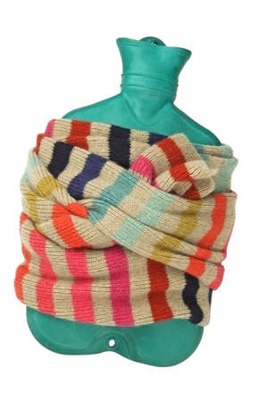 hot water bottle: Hot water bottle in scarf isolated on white  Cold and flu concept