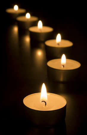 flame like: Small candles burning in the dark  Holiday  romance  religion  meditation concept Stock Photo